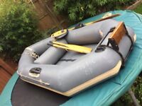 Avon inflatable dinghy with 2 stroke outboard.