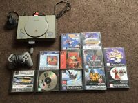 PlayStation 1 with 11 games all cables memory card and pad