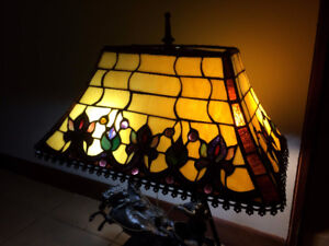 Bronze horse and carriage stained glass table lamp.