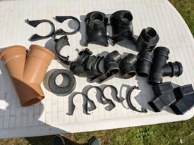 Various downpipe adaptors and underground pipes