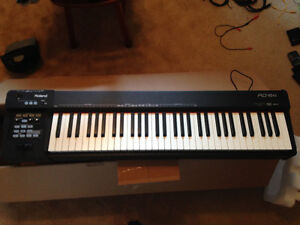 Roland RD-64 stage piano + stand