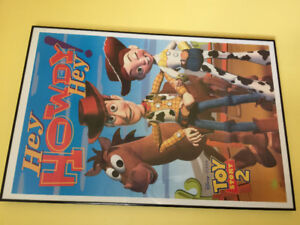 Glass framed Toy Story 2 poster