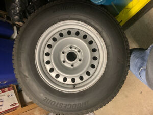 275/70R18 Bridgestone Blizzak tires/w rims for sale w/sensor