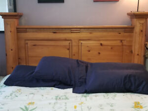 Queen size wood bed frame.