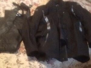 black motor cycle  chaps and jacket