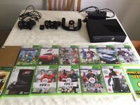 Xbox 360 with controllers and games
