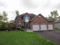 A beautiful executive 2 story, 4 bedroom+den with a huge lot