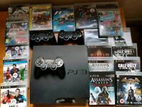 Sony PlayStation 3 inc. 19 games and 3 controllers plus all cables