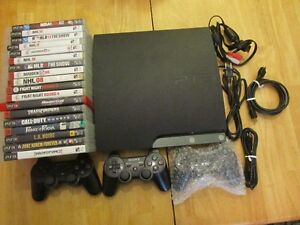 PS3 (32GB), 3 controllers, 18 games, all hook ups.