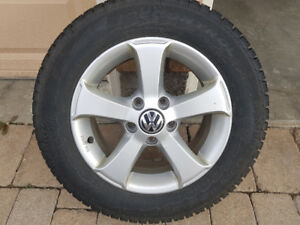 VW  alloy rims and Pirelli Snow Tires