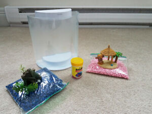 Used Marina Fish Tank with Food, Rocks, and Decor