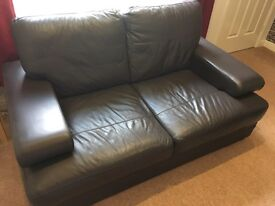Two seater leather look sofa