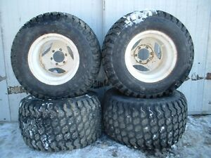 OFF ROAD TIRES AND GM RIMS 6 BOLT ( 31 X 14.5 WIDE X 15)