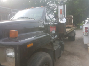 GMC TOPKICK ROLL OFF TRUCK WITH DECK