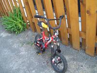 1-VELO UNISEXE 12 POUCES ROUGE-NOIR,SUPER CYCLE KIDZ.
