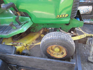 John Deere Riding Mower with a Snow Thrower