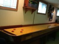Shuffleboard table with scoreboard