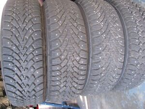 "4 ""BRAND NEW"" GOODYEAR NORDIC STUDDED WINTER TIRES AND RIMS"