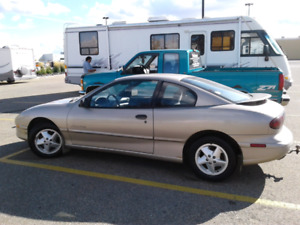 1997  Pontiac Sunfire only 157km . Drives Great . Cheap on Gas