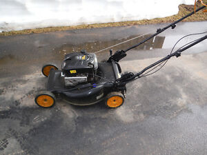 A POULAN PRO SELF PROPELLED LAWN MOWER WITH GRASS PICK UP BAG