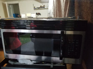 "GE Profile 30"" stainless steel over the range microwave cooker"