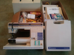 Husqvarna sewing n embroidery machine with parts and supplies
