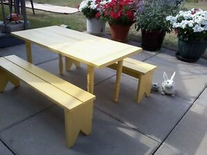 home crafted Kids table and 2 bench set. Painted yellow.