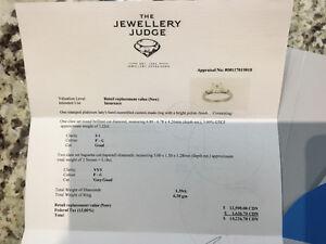 High end diamond ring.  1.2 ct center diamond, $14000 appraisal