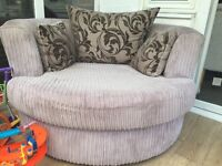 DFS swivel chair with scatter cushions