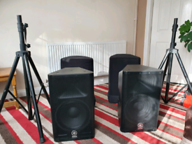 Yamaha DXR 12 Speakers with stands and covers