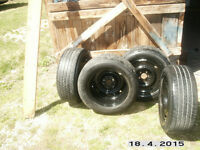 Four 16 inch Ford Rims with tires
