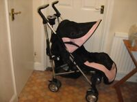 Pink and black silver cross buggy with matching foot muff