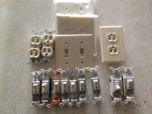 Ivory Duplex outlets, 3 way & 2 way switches, wall plates.