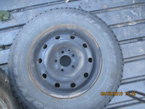 4 Goodyear Ultra Grip Studded tires and rims ford ranger mazda b