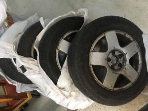 4 Pneus Premier A/S de Michelin montés sur des mags de Volks