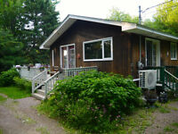 BUNGALOW IN PRIVATE SETTING WITHIN WALKING DISTANCE TO BEACH!