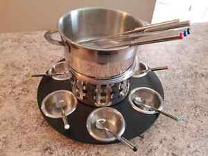 Fondue set with spinning base. Excellent condition.