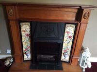 Electric fire and ornate Pine fire surround
