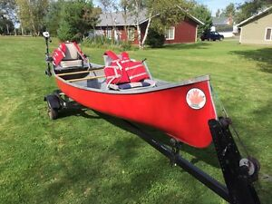 15 foot canoe, trailer, electric motor, batteries.
