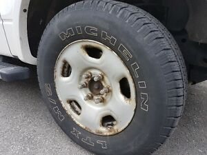 4 steel rims/tires Michelin for Ford