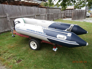 11 Ft. Inflatable boat and Mercury 9.9 HP outboard