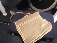 Carry-on travel garment bag with pockets and 4 hangers $30