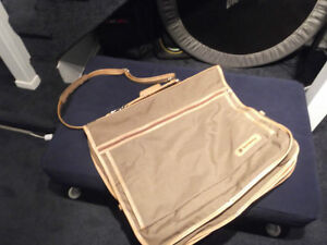 Carry-on travel garment bag with pockets and 4 hangers $25