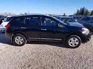 2012 Nissan Rogue SL. $7,900. AND. AUTO.
