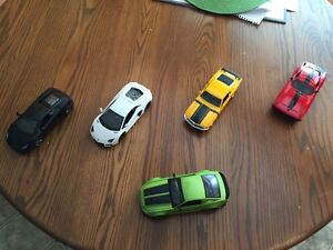 Five 1/24 scale diecast cars