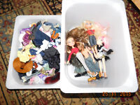 Bratz dolls and tons of clothes and extras