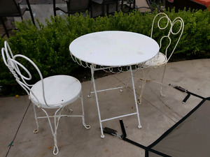 3 piece wrought iron round table and 2 chairs