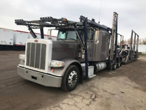 2012 Peterbilt 388 and 2012 Delevan 4000GS trailer strapped