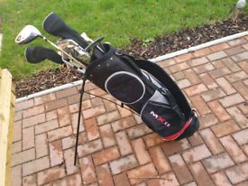 Golf clubs, bag, balls, ties gloves and clothing