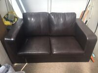 Two seater small brown leather settee
